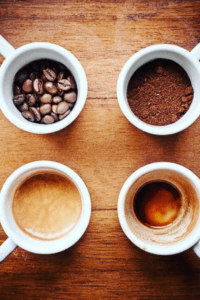 Four coffee cups with different stages of cofee