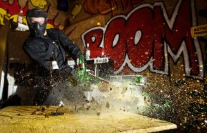 Rage room participant smashing bottles