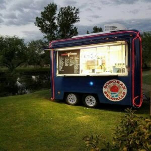 Sonoran Snoballs mini blue trailer with twinkle lights